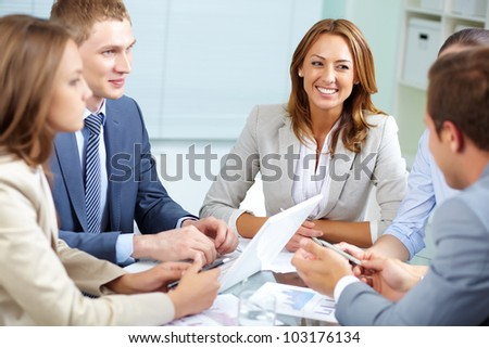 Image of business partners discussing plans at meeting - stock photo