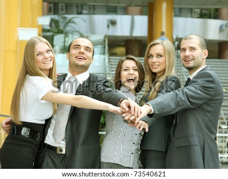 Image of business partners hands on top of each - stock photo