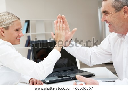 Image of business partners with their palms opposite each other symbolizing support - stock photo