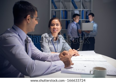 Image of business partners working with the project before deadline - stock photo