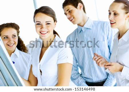 Image of business people at meeting discussing project - stock photo