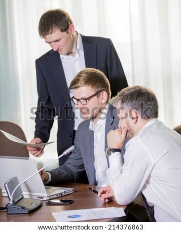 Image of Business people discussing plans or ideas at meeting financial