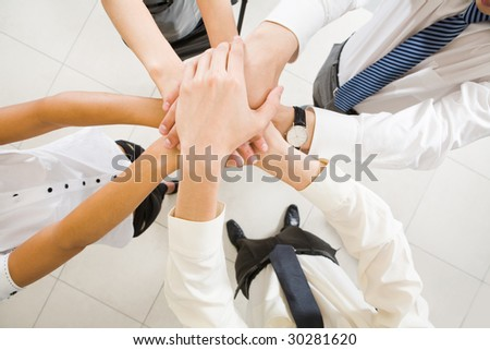 Image of business people hands on top of each other symbolizing support and power - stock photo