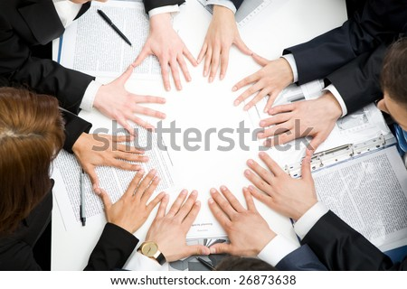 Image of business people keeping their hands next to each other in the form of circle - stock photo