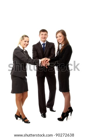 Image of business people putting their hands on top of pile and smiling. Isolated on white background - stock photo