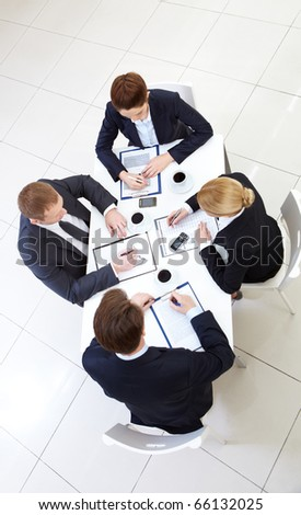 Image of business people working with papers at meeting - stock photo