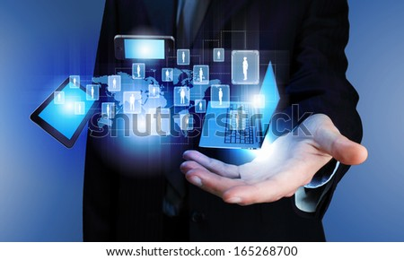 Image of business person holding devices in hands - stock photo