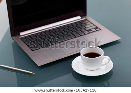 Image of business table with a cup of coffee and norebook