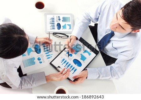 Image of business team at the meeting discussing chart