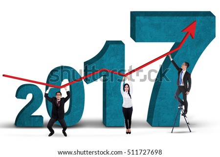 Image of business team holding growth graph for year 2017, isolated white background