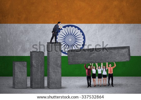 Image of business team make financial chart together with Indian flag backdrop - stock photo
