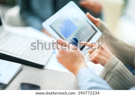Image of business team sitting at the table and discussing a new - stock photo