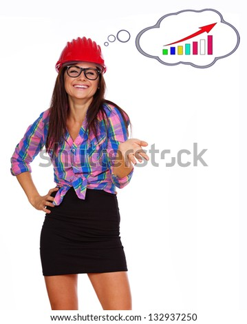 Image of business woman in red helmet who is happy that some statistics at work are growing