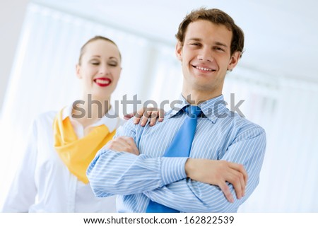 Image of businessman and businesswoman smiling joyfully