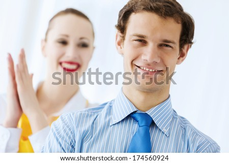 Image of businessman and businesswoman smiling joyfully - stock photo