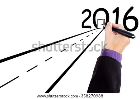 Image of businessman drawing a road with a door and numbers 2016 - stock photo