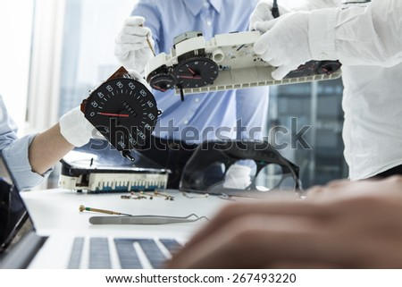 Image of businessman fixing car meter at office