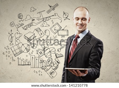 Image of businessman holding ipad. Collage drawings - stock photo