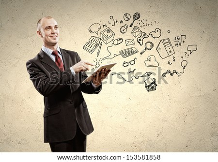 Image of businessman holding tablet - stock photo