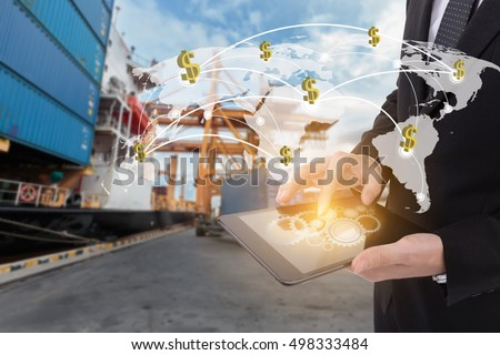 Image of businessman holding tablet ,Finance concept on Global network coverage world map , Logistic Import Export background (Elements of this image furnished by NASA)