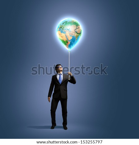 Image of businessman in goggles holding globe. Protect planet. Elements of this image are furnished by NASA