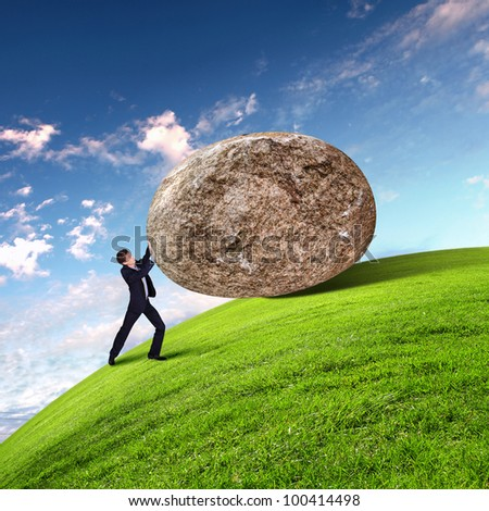 Image of businessman rolling a giant stone - stock photo