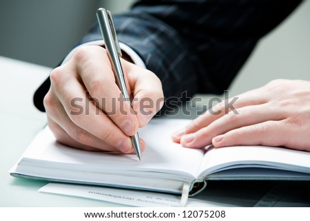 Image of businessman's hands over the notepad - stock photo