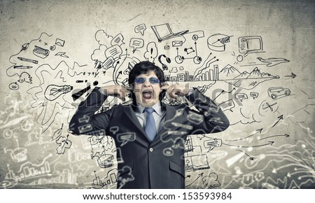 Image of businessman stopping his ears. Long working hours - stock photo