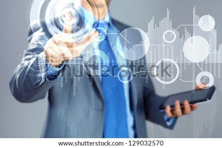image of businessman touching screen with finger holding pad - stock photo