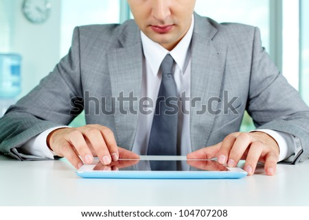 Image of businessman working with digital tablet at workplace - stock photo