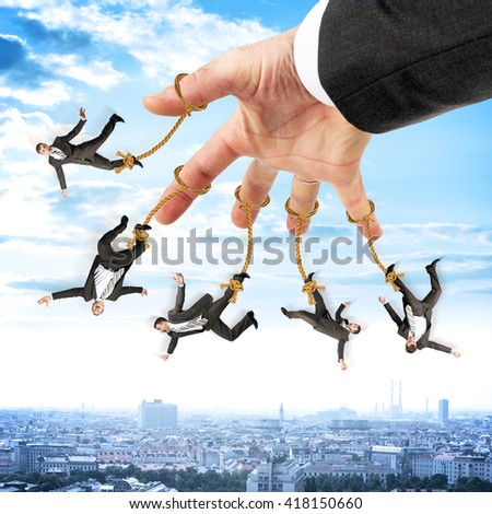Image of businessmen hanging on strings like marionette. Conceptual photography - stock photo