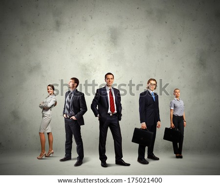 Image of businesspeople group posing. Teamwork concept