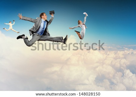 Image of businesspeople jumping high in sky - stock photo