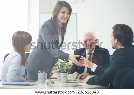Image of businesspeople shaking hands during business meeting