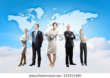 Image of businesspeople standing against world map background - stock photo