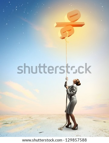 Image of businesswoman climbing the rope attached to percentage sign - stock photo