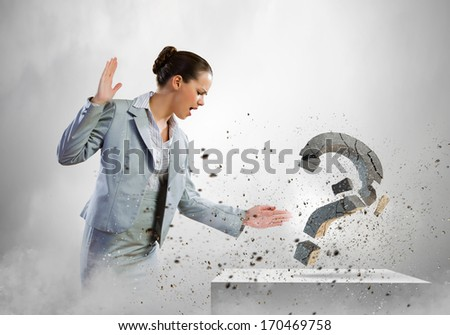 Image of businesswoman destroying with arm stone question mark - stock photo