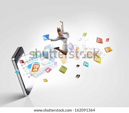 Image of businesswoman jumping out of mobile phone