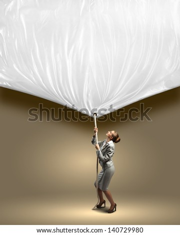 Image of businesswoman pulling blank banner. Place for text - stock photo