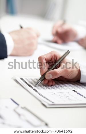 Image of businesswoman?s hand writing - stock photo