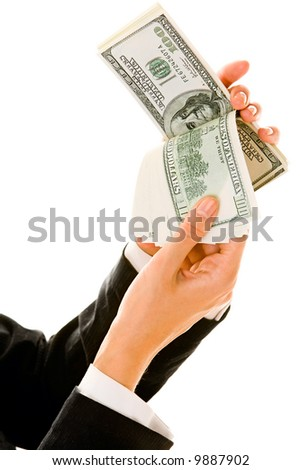 Image of businesswoman's hands holding US dollars and counting them isolated on white background