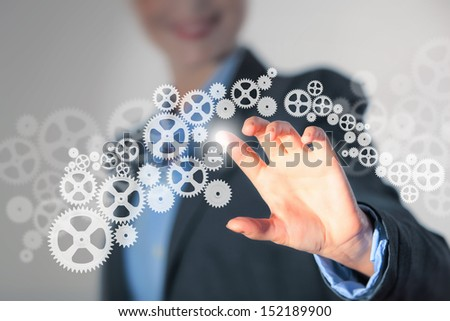 Image of businesswoman touching gear elements. Mechanism concept - stock photo
