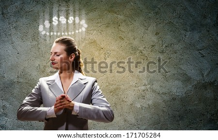 Image of businesswoman with halo above head - stock photo