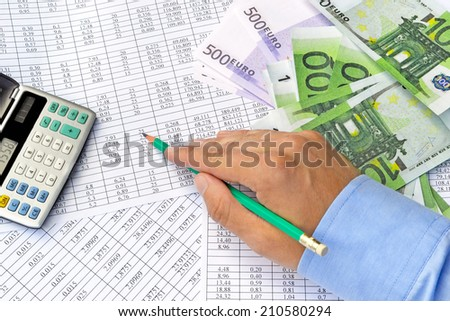 Image of calculating finance hand of financial numbers and euro banknotes - stock photo