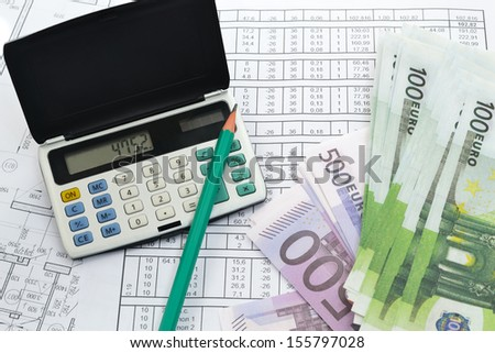 Image of calculator with money and calculations - stock photo