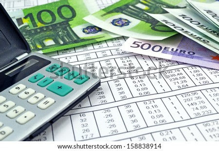 Image of calculator with money 100 and 500 euro and numbers/Money and calculator