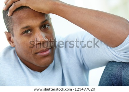 Image of calm African man looking at camera - stock photo