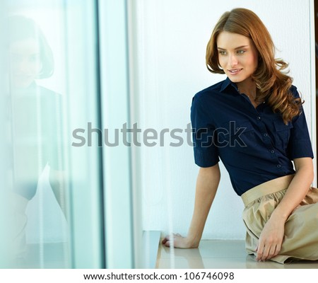 Image of calm woman in smart casual looking aside - stock photo