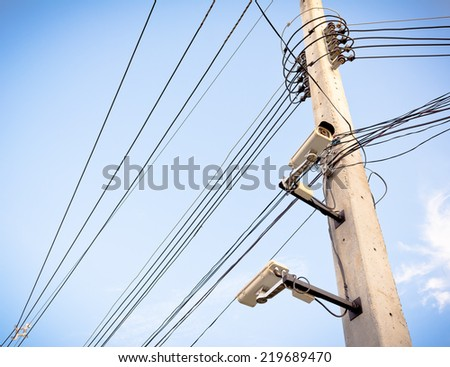 image of cctv camera on electric pole .