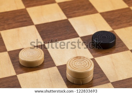 Image of checker pieces on board